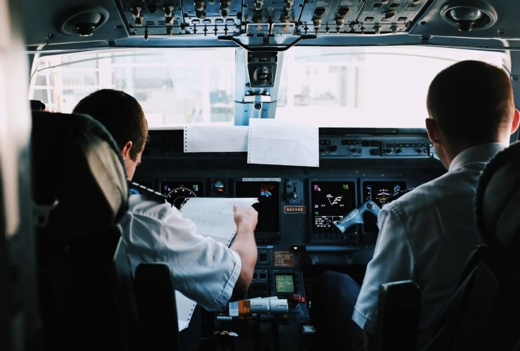 two pilots in airplane cockpit