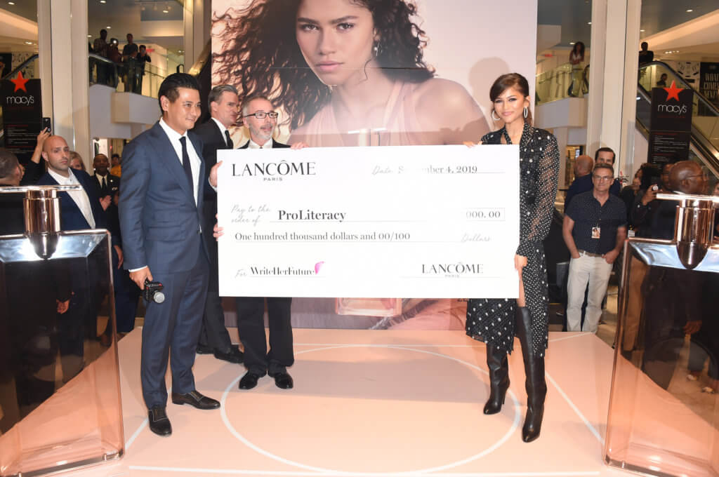 Lancome Brand Ambassador, Zendaya accepts grant check for the Write Her Future Campaign