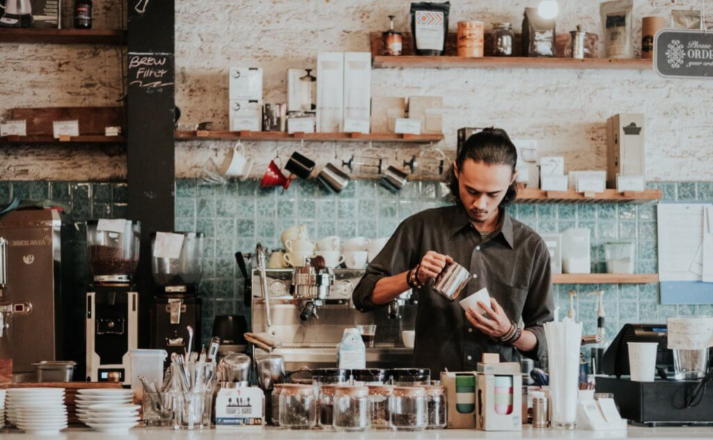 barista making coffee in a cafe